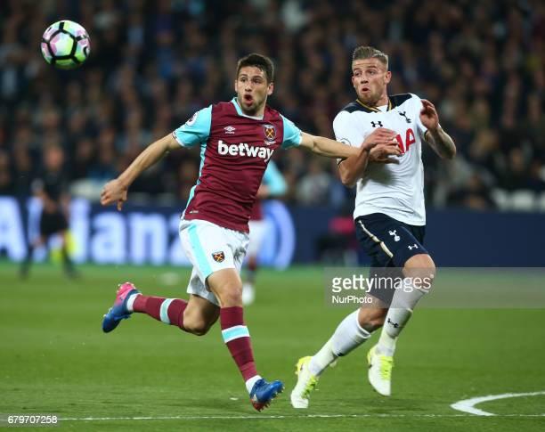 West Ham United's Jonathan Calleri holds of Tottenham Hotspur's Toby Alderweireld during Premier League match between West Ham United against...