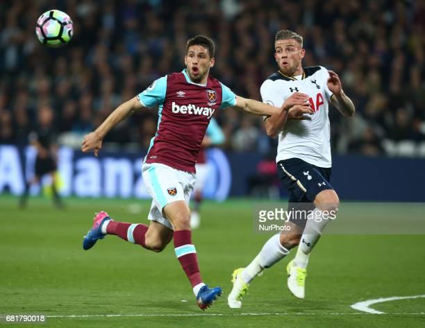 LR West Ham United's Jonathan Calleri holds of Tottenham Hotspur's Toby Alderweireld during Premier League match between West Ham United against...