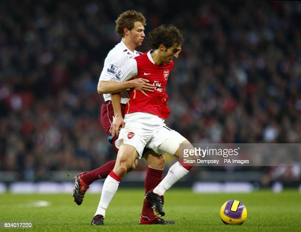 West Ham United's Jonathan Spector and Arsenal's Mathieu Flamini battle for the ball