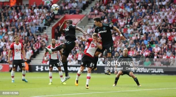 West Ham United's Jose Fonte clears from Southampton's Steven Davis during the Premier League match between Southampton and West Ham United at St...