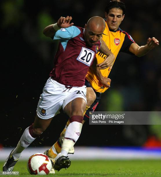 West Ham United's Julien Faubert and Arsenal's Francesc Fabregas battle for the ball