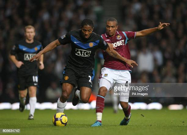 West Ham United's Junior Stanislas and Manchester United's Antonio Valencia battle for the ball