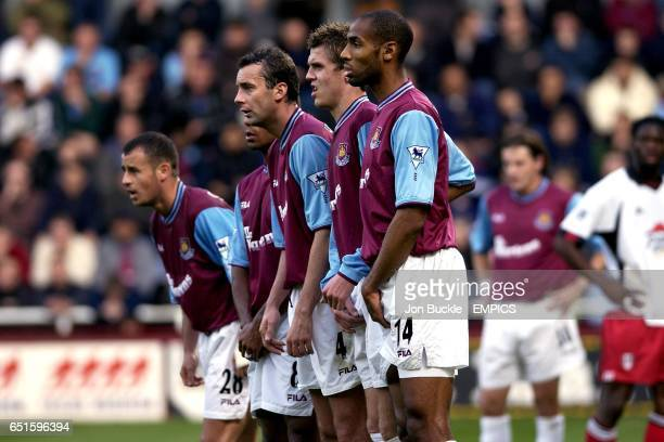 West Ham United's Laurent Courtois Trevor Sinclair Don Hutchison Michael Carrick and Frederic Kanoute form a defensive wall