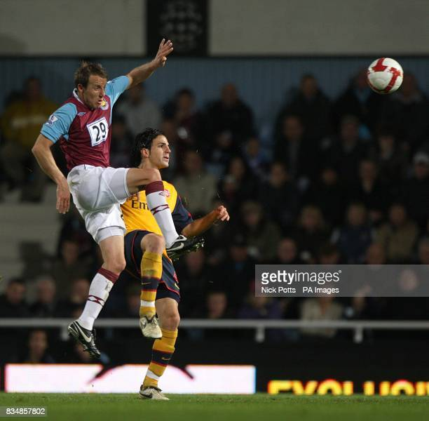 West Ham United's Lee Bowyer and Arsenal's Francesc Fabregas battle for the ball