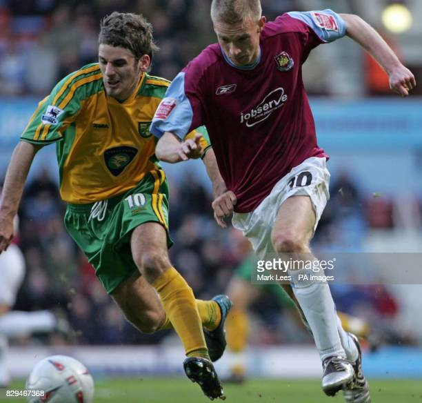 West Ham United's Luke Chadwick tussles with Norwich City's David Bentley