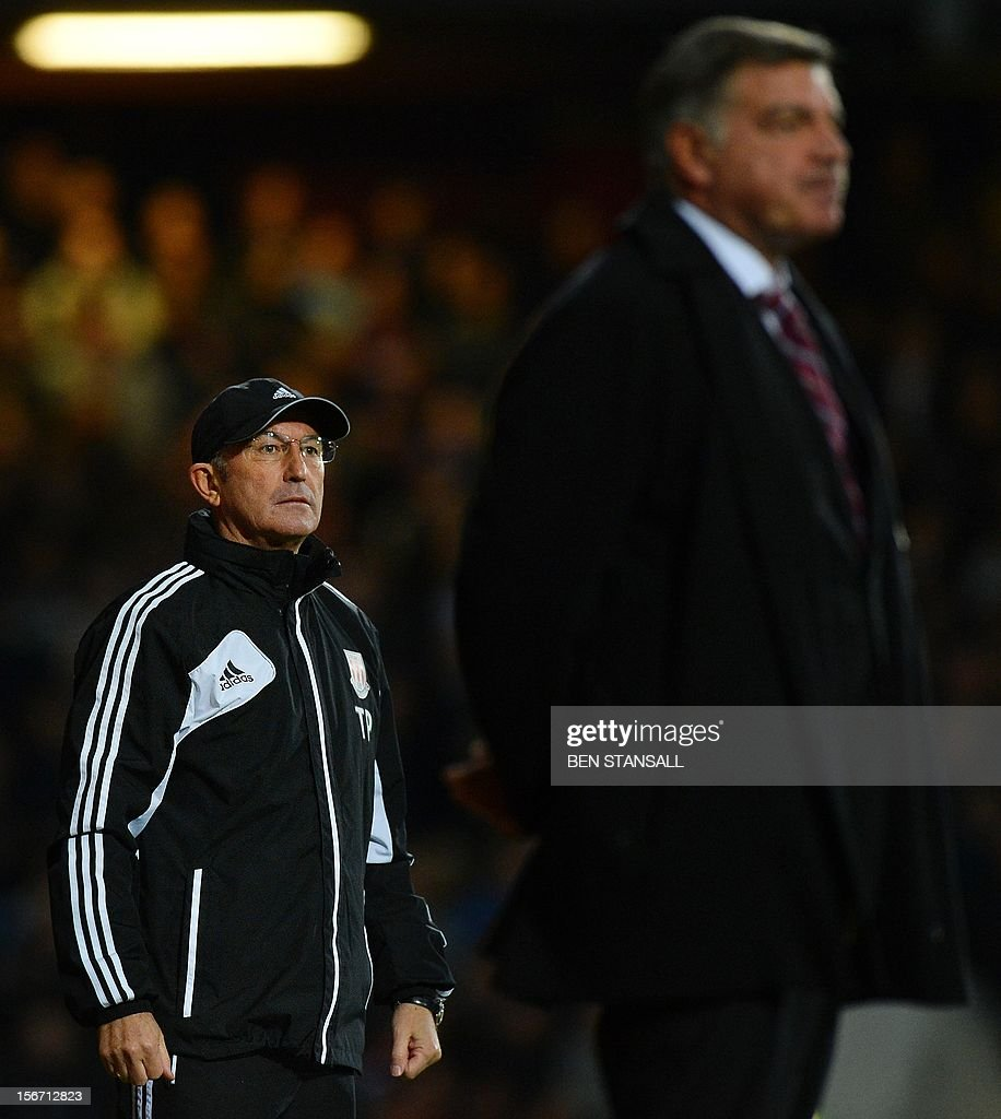 """West Ham United's manager Sam Allardyce (R) and Stoke City manager Tony Pulis (L) look on during the English Premier League football match between West Ham and Stoke City at the Boleyn Ground, Upton Park, in East London, England, on November 19, 2012. USE. No use with unauthorized audio, video, data, fixture lists, club/league logos or """"live"""" services. Online in-match use limited to 45 images, no video emulation. No use in betting, games or single club/league/player publications."""