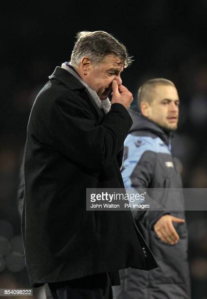 West Ham United's manager Sam Allardyce walks off dejected at the end of the Barclays Premier League match at Craven Cottage London