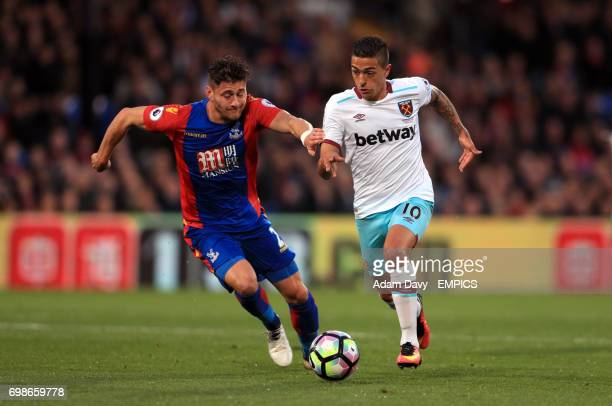 West Ham United's Manuel Lanzini and Crystal Palace's Joel Ward battle for the ball