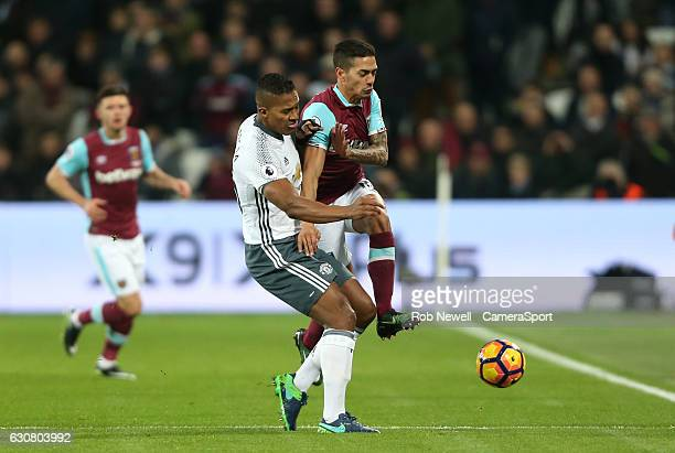 West Ham United's Manuel Lanzini and Manchester United's Luis Antonio Valencia during the Premier League match between West Ham United and Manchester...