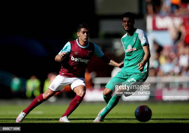 West Ham United's Manuel Lanzini and Werder Bremen's Florian Grillitsch in action