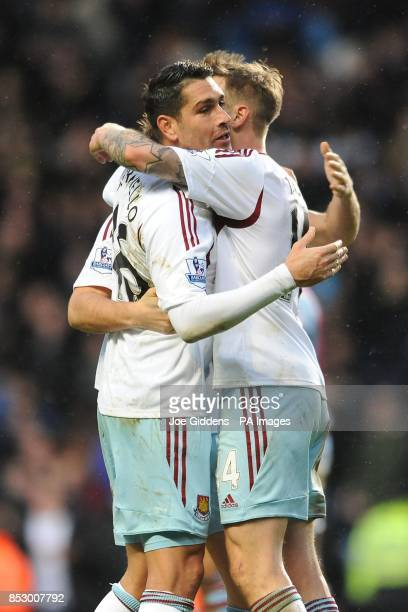 West Ham United's Marco Borriello and Matthew Taylor celebrate at the end of the Barclays Premier League match at Villa Park Birmingham