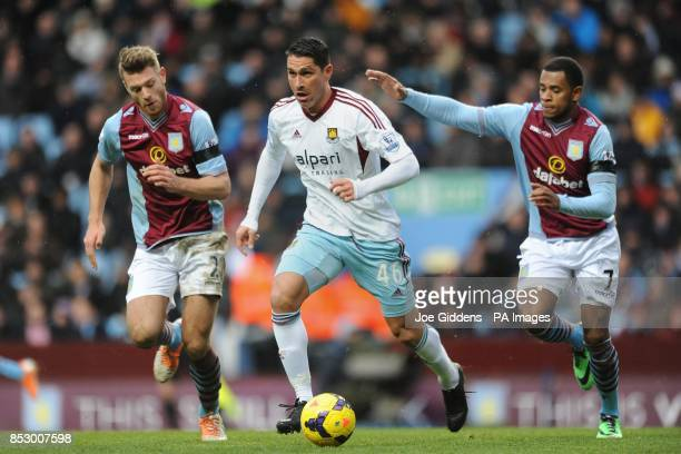 West Ham United's Marco Borriello gets away from Aston Villa's Nathan Baker and Leandro Bacuna during the Barclays Premier League match at Villa Park...