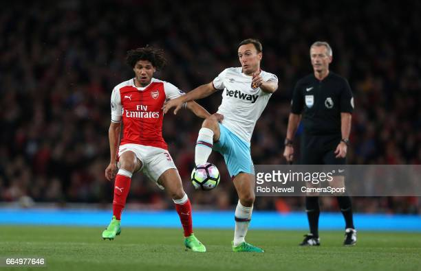 West Ham United's Mark Noble and Arsenal's Mohamed Elneny during the Premier League match between Arsenal and West Ham United at Emirates Stadium on...