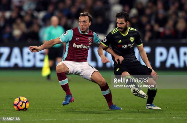 West Ham United's Mark Noble and Chelsea's Francesc Fabregas	during the Premier League match at the London Stadium