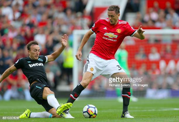 West Ham United's Mark Noble and Manchester United's Nemanja Matic battle for the ball during the Premier League match at Old Trafford Manchester