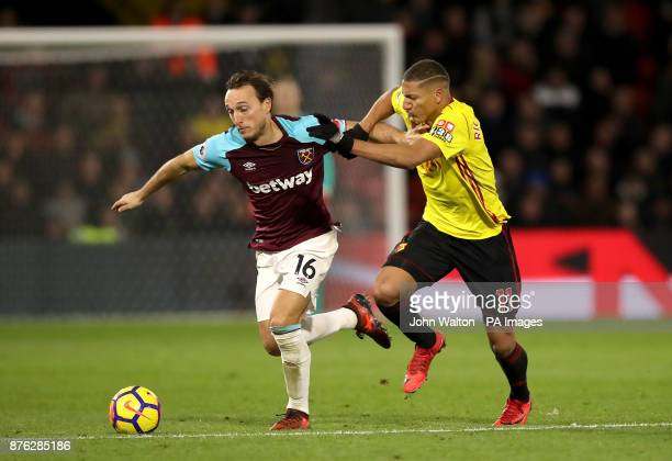 West Ham United's Mark Noble and Watford's Richarlison battle for the ball during the Premier League match at Vicarage Road Watford