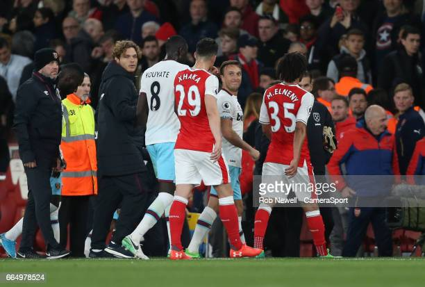 West Ham United's Mark Noble argues with Arsenal's Granit Xhaka after the latter had accused Andy Carroll of elbowing Shkodran Mustafi during the...
