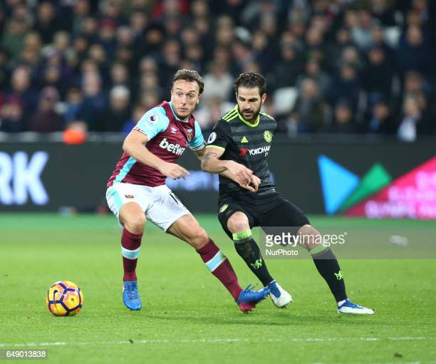 West Ham United's Mark Noble holds of Chelsea's Cesc Fabregas during EPL Premier League match between West Ham United against Chelsea at The London...