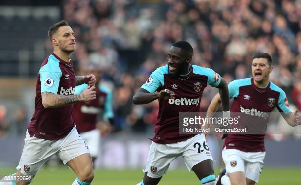 West Ham United's Marko Arnautovic celebrates scoring his side's first goal with Arthur Masuaku and Aaron Cresswell during the Premier League match...