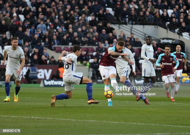 West Ham United's Marko Arnautovic scores his side's first goal during the Premier League match between West Ham United and Chelsea at London Stadium...