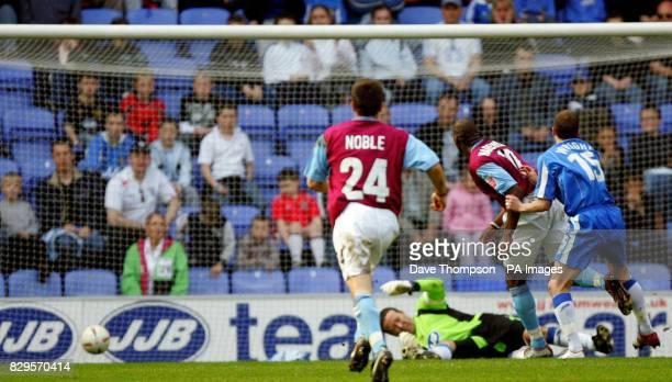 West Ham United's Marlon Harewood bursts through to score the winner against Wigan Athletic
