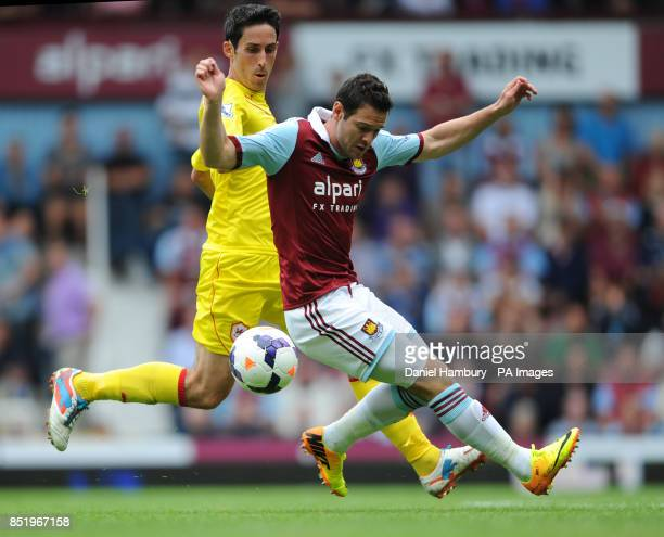 West Ham United's Matt Jarvis and Cardiff City's Peter Whittingham during the Barclays Premier League match at Upton Park London