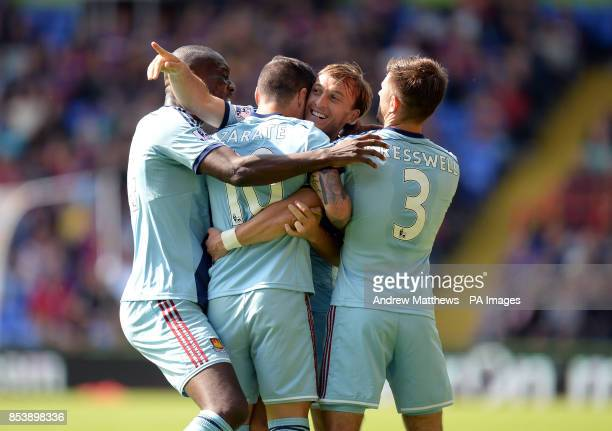 West Ham United's Mauro Zarate celebrates with his team mates after he scores their side's first goal of the game during the Barclays Premier League...