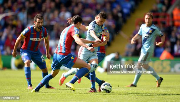 West Ham United's Mauro Zarate gets away from a challenge by Crystal Palace's Martin Kelly during the Barclays Premier League match at Selhurst Park...