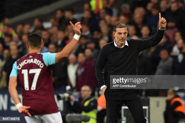 West Ham United's Mexican striker Javier Hernandez and West Ham United's Croatian manager Slaven Bilic gesture during the English Premier League...