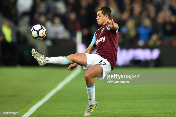 West Ham United's Mexican striker Javier Hernandez controls the ball during the English Premier League football match between West Ham United and...