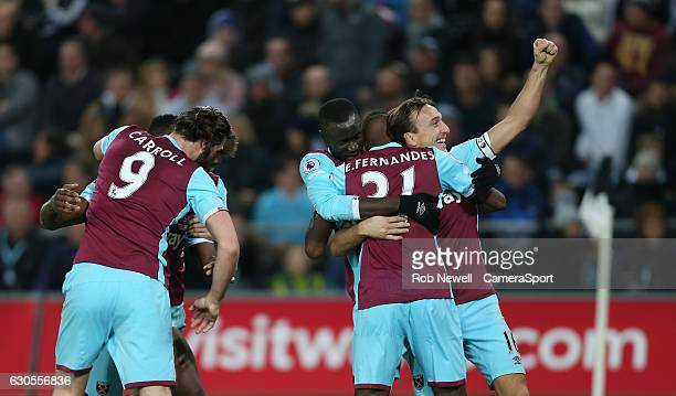 West Ham United's Michail Antonio celebrates scoring his sides third goal with his team mates during the Premier League match between Swansea City...