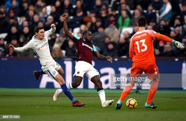 West Ham United's Michail Antonio is challenged by Chelsea's Andreas Christensen andThibaut Courtois during the Premier League match at the London...