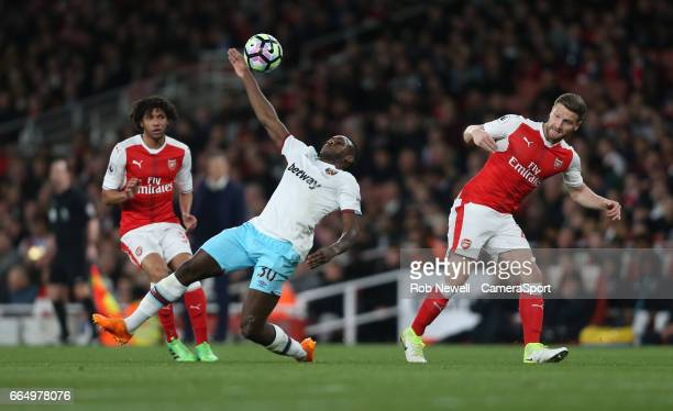 West Ham United's Michail Antonio is taken down by Arsenal's Shkodran Mustafi during the Premier League match between Arsenal and West Ham United at...