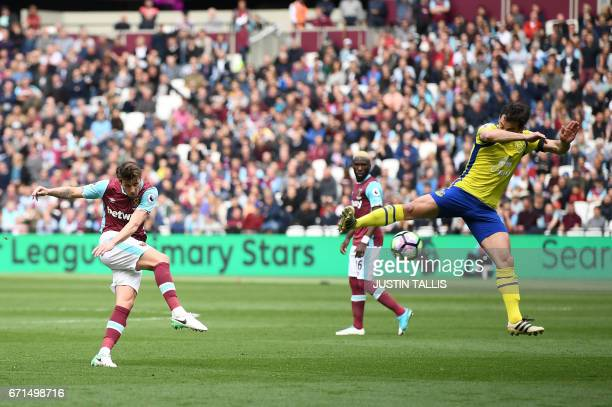 West Ham United's Norwegian midfielder Havard Nordtveit has a shot on goal during the English Premier League football match between West Ham United...