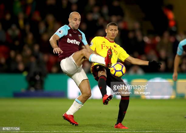 West Ham United's Pablo Zabaleta and Watford's Richarlison battle for the ball during the Premier League match at Vicarage Road Watford