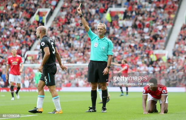 West Ham United's Pablo Zabaleta is shown the yellow card by referee Martin Atkiinson during the Premier League match at Old Trafford Manchester