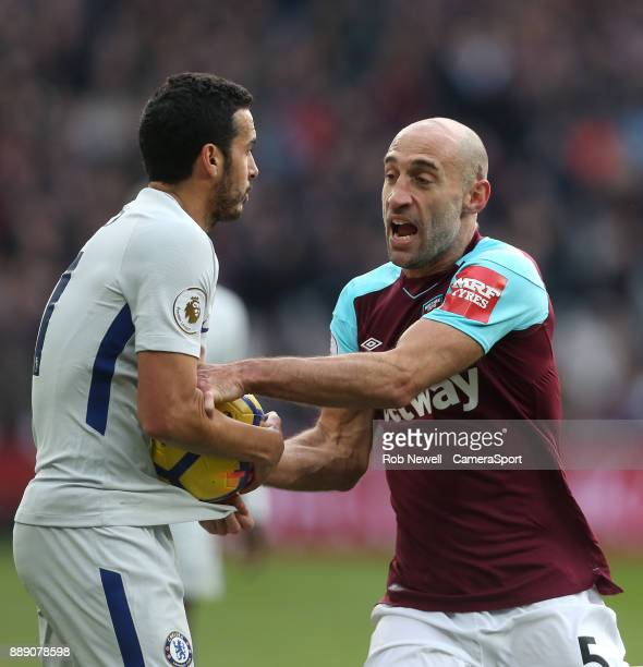 West Ham United's Pablo Zabaleta wrestles for the ball with Chelsea's Pedro during the Premier League match between West Ham United and Chelsea at...