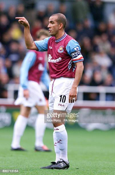 West Ham United's Paolo Di Canio wears a American stars and stripes flag around his left arm during the Premiership match against Newcastle United at...