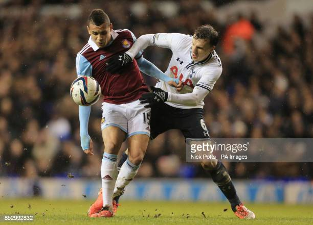West Ham United's Ravel Morrison battles with and beats Tottenham Hotspur's Vlad Chiriches during the Capital One Cup match at White Hart Lane London
