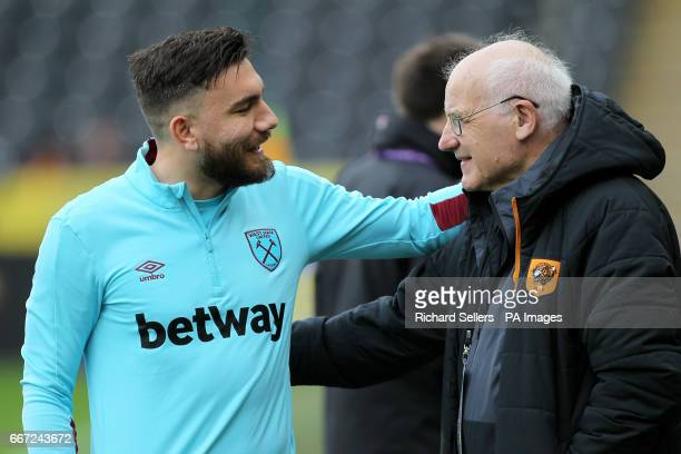 West Ham United's Robert Snodgrass speaks with Hull City kit logistics manager Frank Donoghue before the game