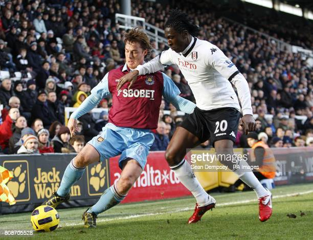 West Ham United's Scott Parker and Fulham's Dickson Etuhu battle for the ball