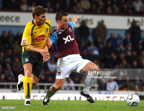 West Ham United's Scott Parker and Plymouth Argyle's Akos Buzsaky battle for the ball