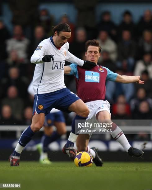 West Ham United's Scott Parker challenges Manchester United's Dimitar Berbatov for the ball
