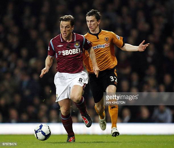 West Ham United's Scott Parker runs with the ball away from Wolverhampton Wanderers Kevin Foley during a Premier League match at Upton Park in London...