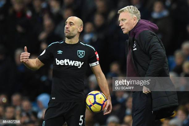 West Ham United's Scottish manager David Moyes gives instructions to West Ham United's Argentinian defender Pablo Zabaleta during the English Premier...