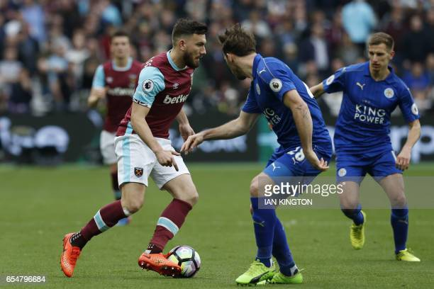 West Ham United's Scottish midfielder Robert Snodgrass vies with Leicester City's Austrian defender Christian Fuchs during the English Premier League...