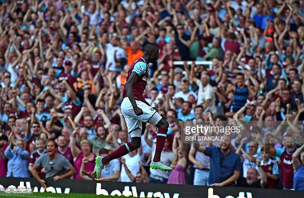 West Ham United's Senegalese midfielder Cheikhou Kouyate celebrates in front of supporters after scoring their second goal during the English Premier...