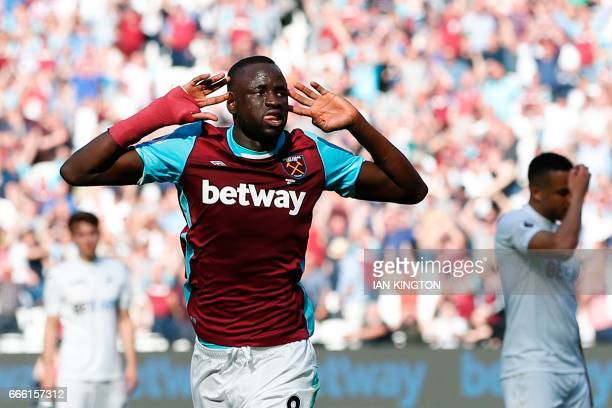 West Ham United's Senegalese midfielder Cheikhou Kouyate celebrates scoring the opening goal during the English Premier League football match between...