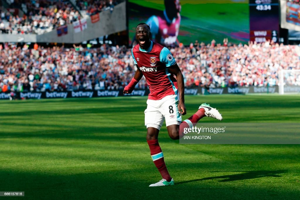West Ham United's Senegalese midfielder Cheikhou Kouyate celebrates scoring the opening goal during the English Premier League football match between West Ham United and Swansea City at The London Stadium, in east London on April 8, 2017. / AFP PHOTO / Ian KINGTON / RESTRICTED TO EDITORIAL USE. No use with unauthorized audio, video, data, fixture lists, club/league logos or 'live' services. Online in-match use limited to 75 images, no video emulation. No use in betting, games or single club/league/player publications. /