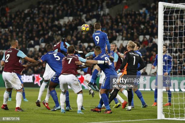 West Ham United's Senegalese midfielder Cheikhou Kouyate scores his team's first goal during the English Premier League football match between West...